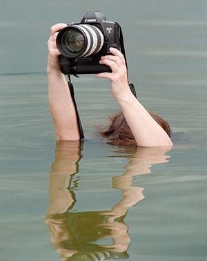 有趣的正在拍摄的摄影师们