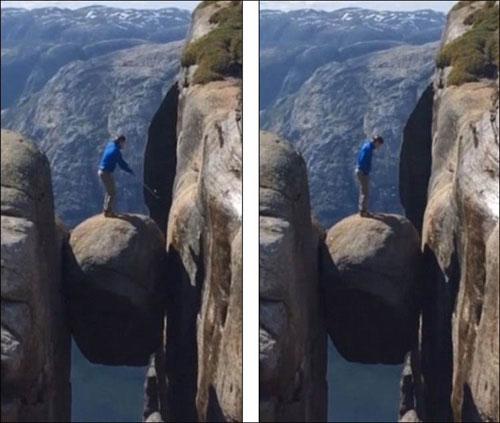 """冰岛男子在千米悬空""""奇迹石""""上打高尔夫"""